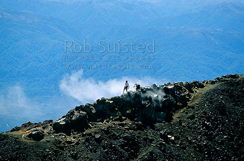A steam fumarole on the summit of Mount (Mt) Ngauruhoe, with the Kaimanawa Range beyond, Tongariro National Park, Ruapehu District, Manawatu-Wanganui Region, New Zealand (NZ) stock photo.