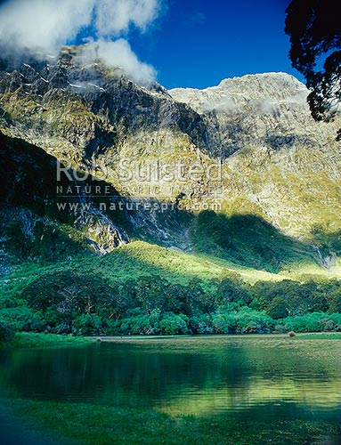 Lake Mintaro and Mount (Mt) Balloon (1853m) on the Milford Track - the 'finest walk in the world', Fiordland National Park, Southland District, Southland Region, New Zealand (NZ) stock photo.