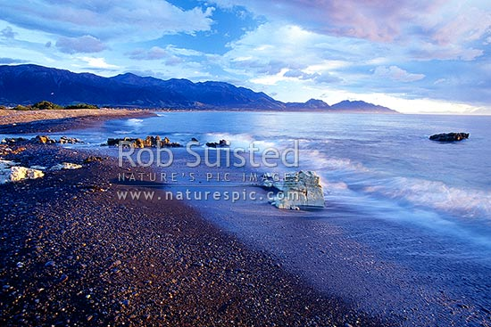 Morning at Kaikoura with a NW storm brewing over the Kaikoura Ranges, Kaikoura, Kaikoura District, Canterbury Region, New Zealand (NZ) stock photo.