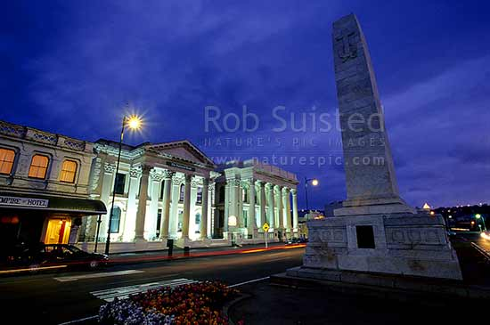 Historic Bank of Otago (1871) and NSW Bank (1883) Buildings and War Memorial statue - Oamaru limestone, Oamaru, Waitaki District, Canterbury Region, New Zealand (NZ) stock photo.