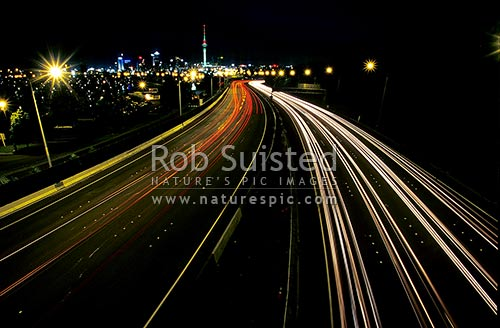 Auckland City Skyline, Sky Tower and motorways at night with car light streaks, Auckland, Auckland City District, Auckland Region, New Zealand (NZ) stock photo.