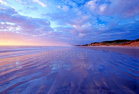 Sunset on Ocean Beach, Strahan, Australia stock photo.