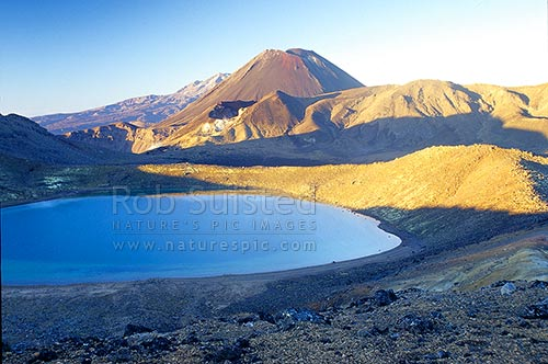 Blue Lake, Red Crater of Mount Tongariro, Mount (Mt) Ngauruhoe (2287m) and Mount (Mt) Ruapehu (obscured). Tongariro crossing tramping track, Tongariro National Park, Taupo District, Waikato Region, New Zealand (NZ) stock photo.