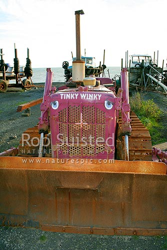 One of the comically painted bulldozers used to haul ashore fishing boats at Ngawi Fishing village, Ngawi, South Wairarapa District, Wellington Region, New Zealand (NZ) stock photo.