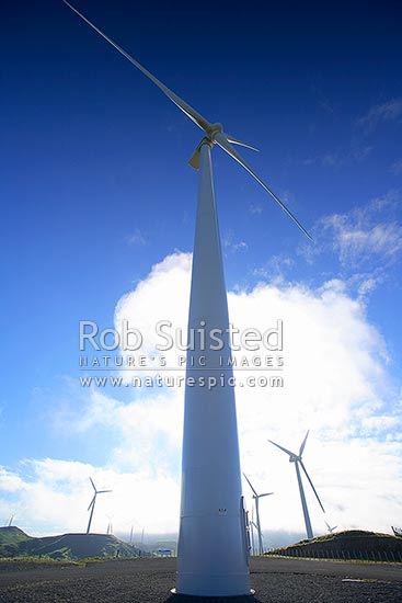 Te Apiti wind farm turbines over farmland (towers 70m high, 35m blades). 90 MW installed capacity, Ashhurst, Manawatu District, Manawatu-Wanganui Region, New Zealand (NZ) stock photo.