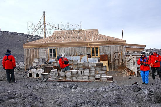 Tourists visiting Ernest Shackleton's British Antarctic (Nimrod 1907-09) Expedition hut, Cape Royds, Ross Island, Antarctica stock photo.