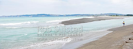 Recreational fisherman fishing at the Tukituki, Ngaruroro and Clive River mouths sandbar on the Napier foreshore, Clive, Hastings District, Hawke's Bay Region, New Zealand (NZ) stock photo.