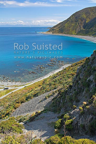 Looking along Wellington's South Coast, over Cook Strait, towards the South Island, from near Read Rocks and Sinclair Head, Wellington, Wellington City District, Wellington Region, New Zealand (NZ) stock photo.