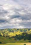 Rolling hill country under clouds