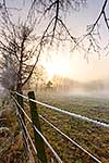 Sunrise over frosty rural landscape