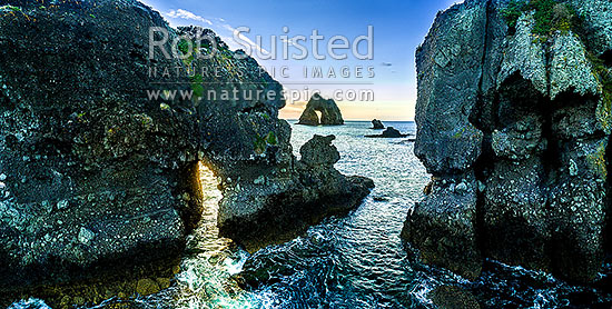 Motukoruenga Island and rocks, with Needle Island behind centre. Hole in the rock in Hole in the Wall channel. Panorama, Opito Bay, Coromandel Peninsula, Thames-Coromandel District, Waikato Region, New Zealand (NZ) stock photo.