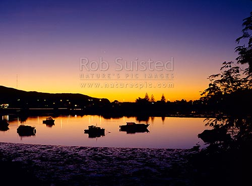 Sunset and boats at Pauatahanui inlet, Paremata, Wellington, Wellington City District, Wellington Region, New Zealand (NZ) stock photo.