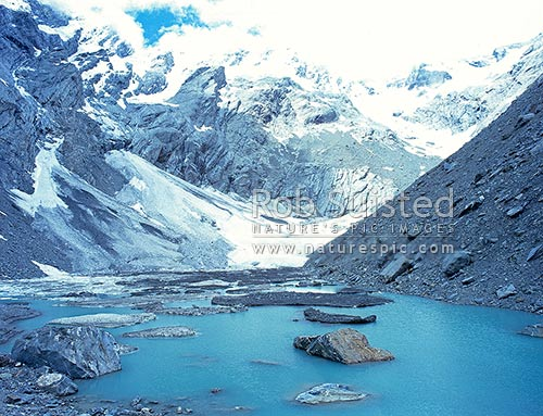Terminal alpine lake and icebergs at the head of Harper's Rock Flat, below the Fyre Glacier & Main divide. Westland National Park, Douglas River, Westland District, West Coast Region, New Zealand (NZ) stock photo.
