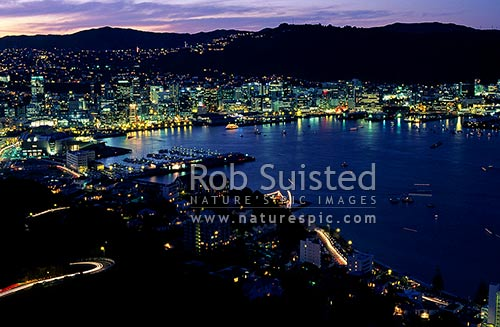 Wellington city and harbour at night from Mount (Mt) Victoria, Wellington, Wellington City District, Wellington Region, New Zealand (NZ) stock photo.