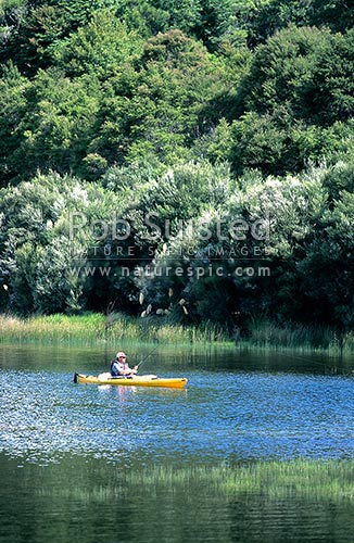 Trout fishing from a kayak in Te korokoroowhaitiri Bay - Lake Waikaremoana, Te Urewera National Park, Te Urewera National Park, Wairoa District, Hawke's Bay Region, New Zealand (NZ) stock photo.
