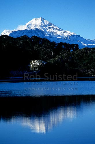 Mount (Mt) Aspiring (3030m) reflected in Lake Leeb, Thomson Range, South Westland, Westland District, New Zealand (NZ) stock photo.