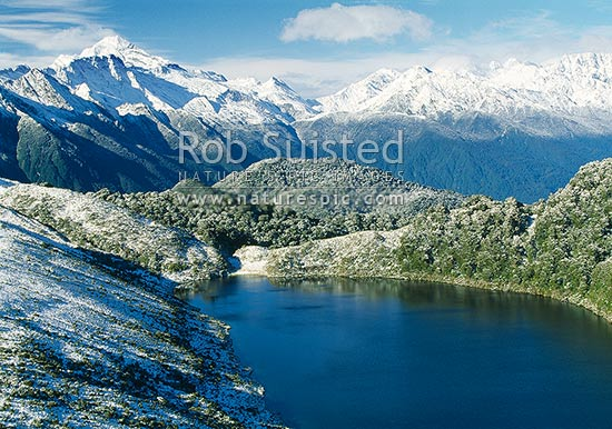 South over Lake Leeb (970m) and Thomson Range towards Mount (Mt) Aspiring (left), South Westland, Westland District, West Coast Region, New Zealand (NZ) stock photo.
